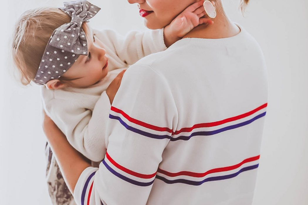 mom and daughter, mom and baby, cute baby girl playing with earrings