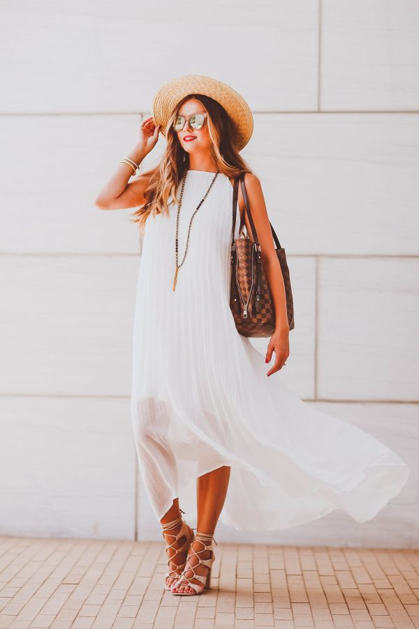 summer outfit, straw boater hat, white pleated dress, beige lace-up block heel sandals, le specs reflective sunglasses, louis vuitton damier ebene cabas rivington tote